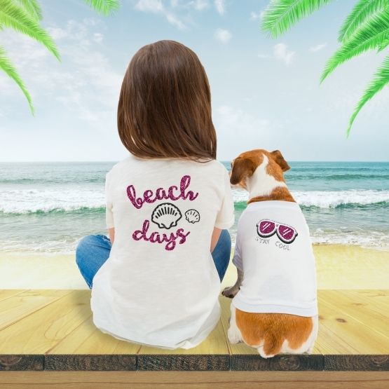 image of girl and dog displaying their htv heat transfer vinyl